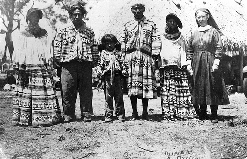 Deaconess Bedell posing with Miccosukee Indians at their camp