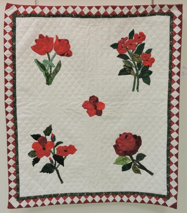 Directement inspirée des Fleurs Rouges d'Annick Huet, Simone Flores a su restituer
