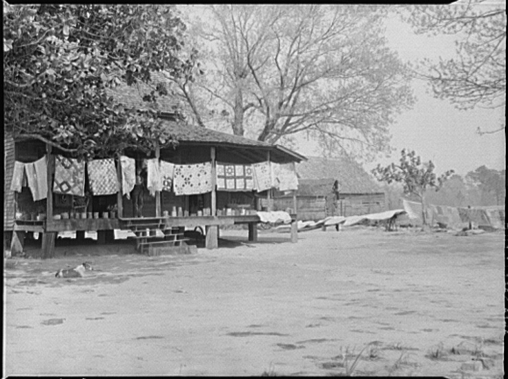 """""""Typical farmhouse, spring housecleaning, homemade quilts and bedding in sun. Coffee County, Alabama."""" Photos taken April 1939 by Marion Post Wolcott."""